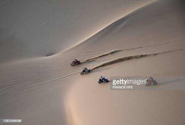 TOPSHOT Bikers compete during the Stage 9 of the Dakar 2019 in and around Pisco Peru on January 16 2019