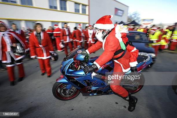 Bikers dressed as Santa Claus parade to collect funds on December 17 2011 at La RochesurYon western France The bikers volunteers from the charity 'La...