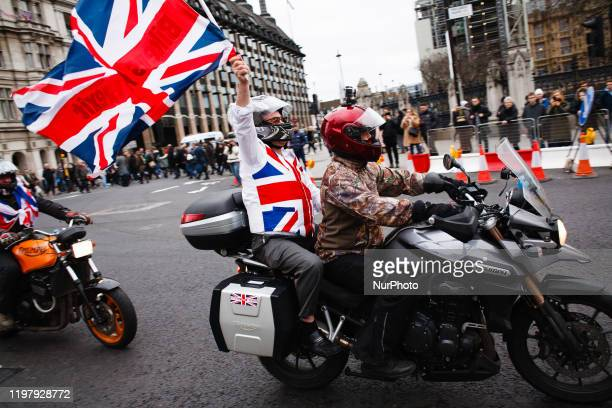 Bikers For Brexit' group waving a Union Jack flag ride through Parliament Square in London, England, on January 31, 2020. Britain's exit from the...