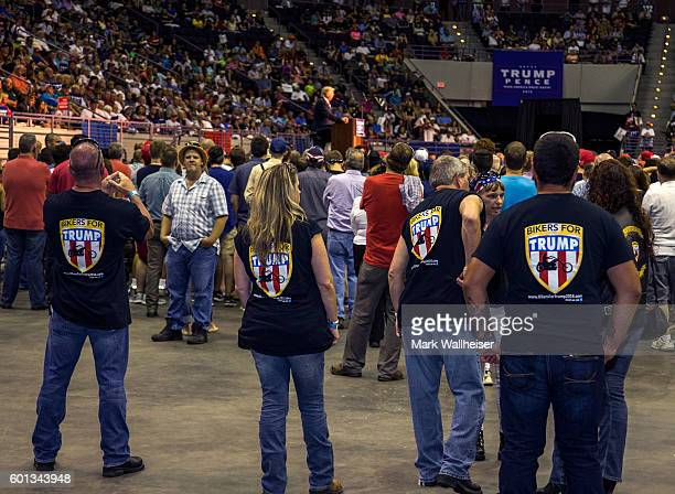 Bikers for Trump stand in the back and listen as Republican Presidential candidate Donald Trump delivers his message during a rally at the Pensacola...