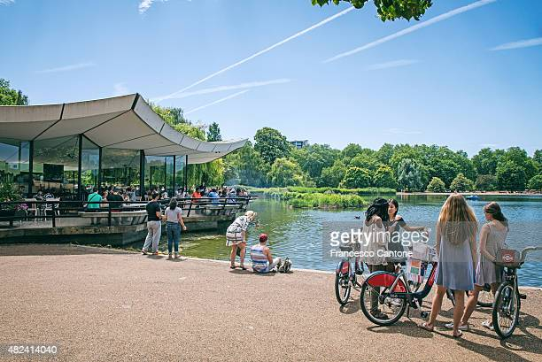 bikers have a rest near the serpentine in hyde park - hyde park london stock photos and pictures