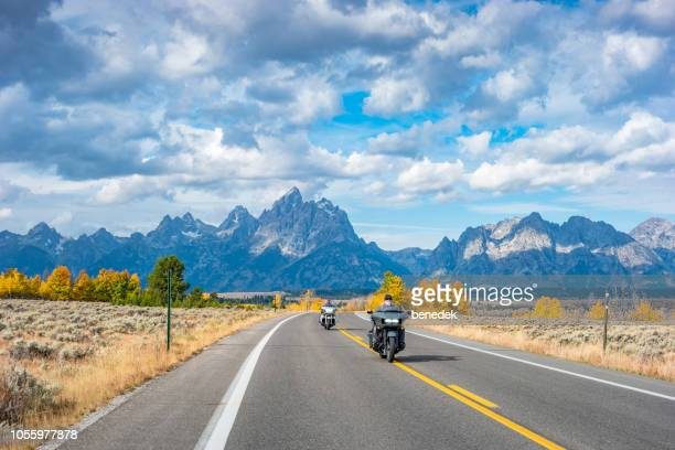 bikers in grand teton national park - grand teton national park stock pictures, royalty-free photos & images