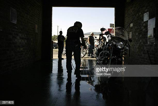 Bikers line up to wash their bikes at a car wash at the annual Sturgis Motorcycle Rally August 5 2003 in Sturgis South Dakota The weeklong rally...