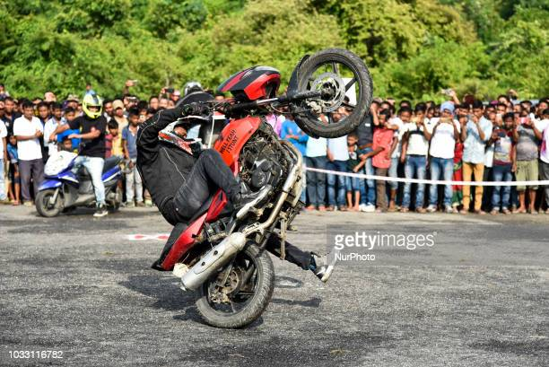 Bikers performing bike stunt adventure sport during NEATOFEST The North East Adventure Tourism Festival organized by Indian Institute of...