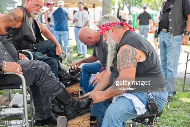 Bikers polishing boots