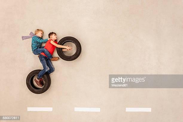 Bikers pulling a wheelie
