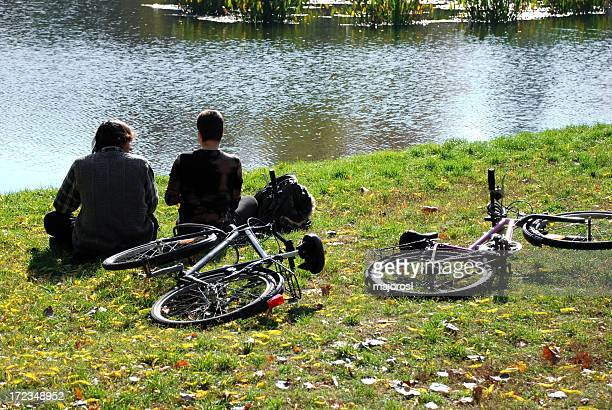bikers resting at the lakeside