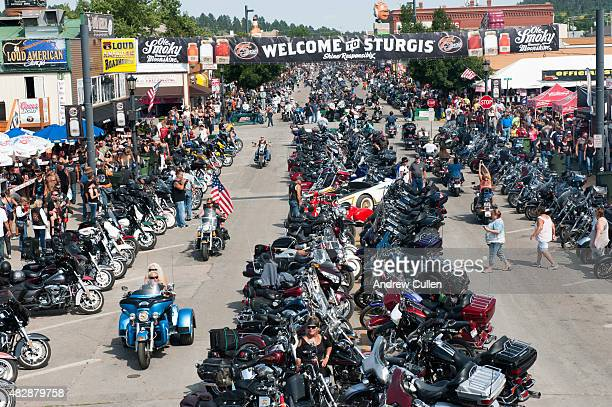 Bikers ride down Main Street on the first day of the annual Sturgis Motorcycle Rally August 3 2015 in Sturgis South Dakota This year marks the 75th...