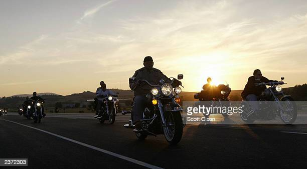 Bikers ride during the annual Sturgis Motorcycle Rally August 5 2003 on the outskirts of Sturgis South Dakota The weeklong event is expected to draw...