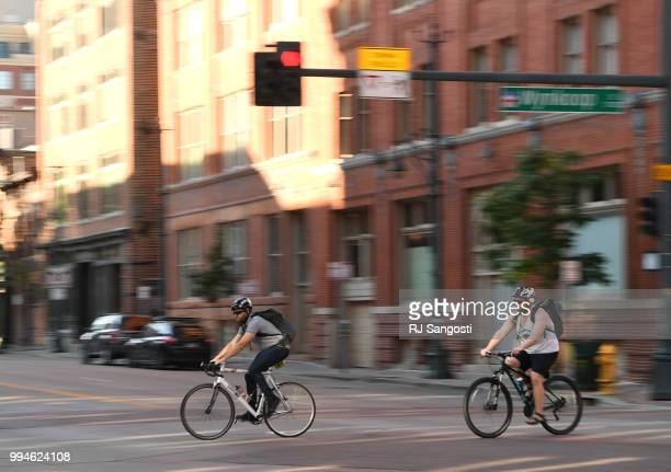 Bikers rides near Intersection at Wynkoop St and 15th St on July 9 2018 in Denver Colorado Colorado Governor John Hickenlooper signed a bike law that...