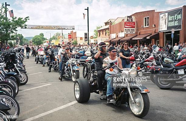 Bikers roll down main street during the 61st annual motorcycle rally held 0612 August 2001 in Sturgis South Dakota Thousands of bikers from around...