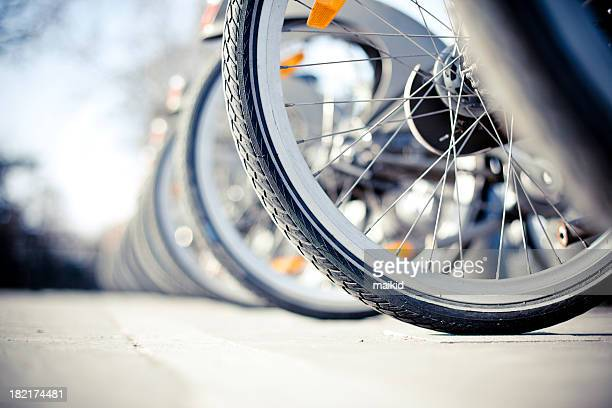 bikes for rent - bicycle parking station stock photos and pictures