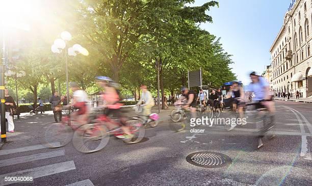 Bikes, getting green light, motion blur. Kungstradgarden