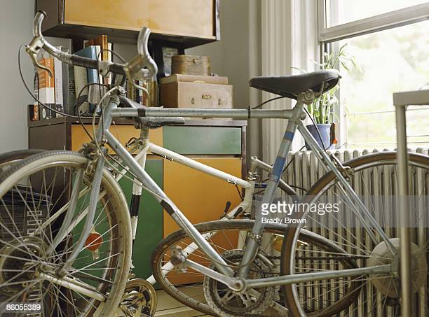 Bikes in cluttered apartment