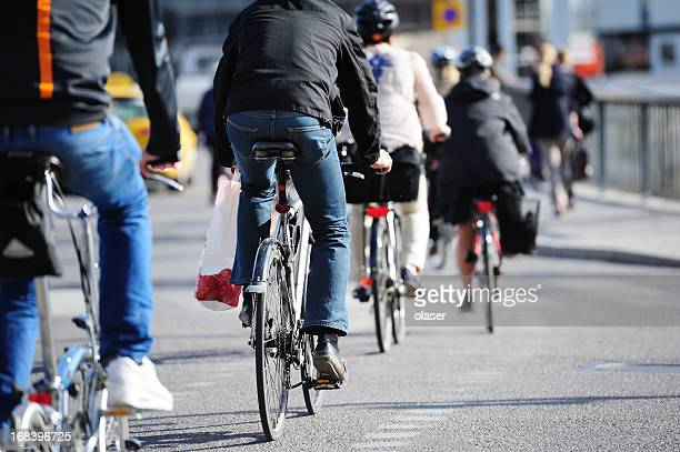 bikes in traffic - stockholm stock pictures, royalty-free photos & images