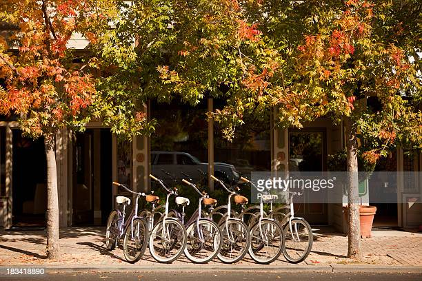 Bikes line the street in a small town