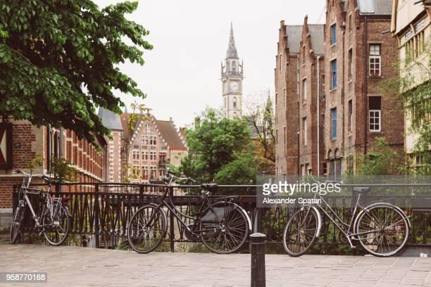 bikes near canal in ghent, belgium - ベルギー ゲント ストックフォトと画像