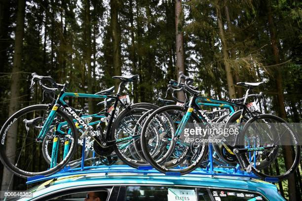 Bikes of the Kazakhstan's Astana Pro cycling team are pictured hung on the roof of a team car during the 2125 km third stage of the 104th edition of...