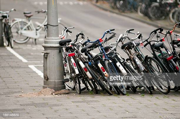 bikes parked in the city amsterdam, netherlands - large group of objects stock pictures, royalty-free photos & images
