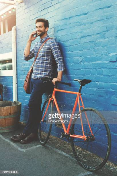 bikes take you there and cellphones show you where - checked shirt stock photos and pictures