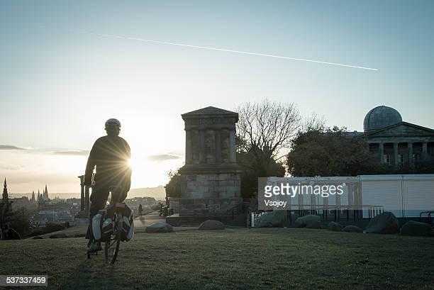 biking at calton hill edinburgh - vsojoy stock pictures, royalty-free photos & images
