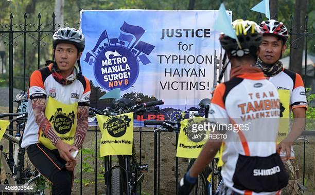 Biking groups from Metro Manila prepare ahead of an early morning bikerun around the Quezon City memorial circle in suburban Manila on November 8 in...