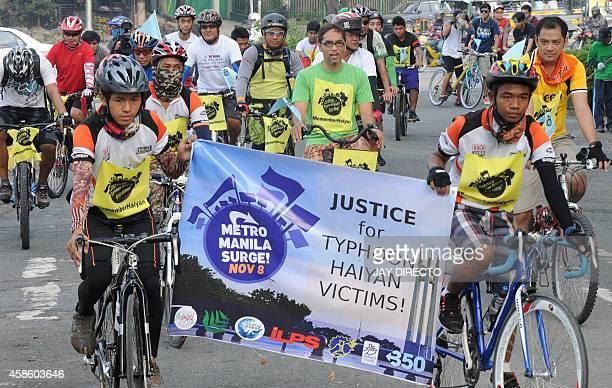 Biking groups from Metro Manila take part in an early morning bikerun around the Quezon City memorial circle in suburban Manila on November 8 in...