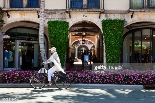 Biking in Worth Avenue pass Via Amore Worth Avenue in Palm Beach is one of the premier upscale shopping streets in the world Distinguishing Worth...