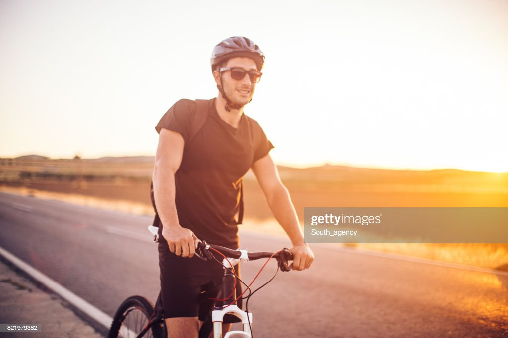 Biking on country road : Stock Photo