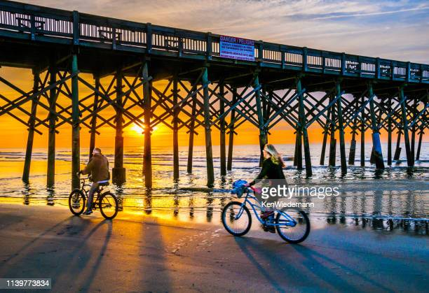 biking on the beach - template_talk:south_carolina stock pictures, royalty-free photos & images