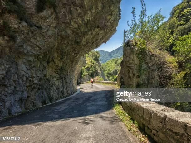 Biking Quit Road with Rock Overhang