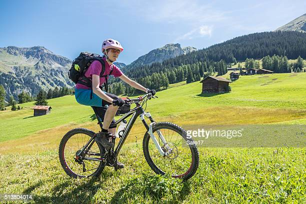 biking the pastures of graubünden, switzerland - cross country cycling stock photos and pictures