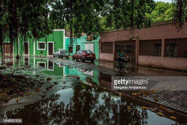 Biking the streets of Valladolid between water puddles