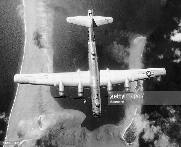 """Bikini Island-This striking aerial photo shows a B-29 Superfortress of the 58th very heavy bombardment group, """"The Atomic Air Force,"""" approaching..."""