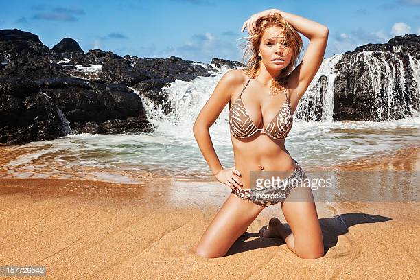 bikini model posing on remote hawaiian beach - legs spread woman stock photos and pictures