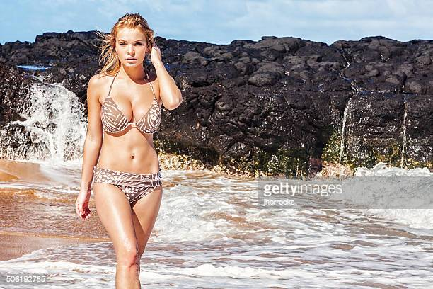 bikini model posing on remote hawaiian beach - buxom blonde stock photos and pictures