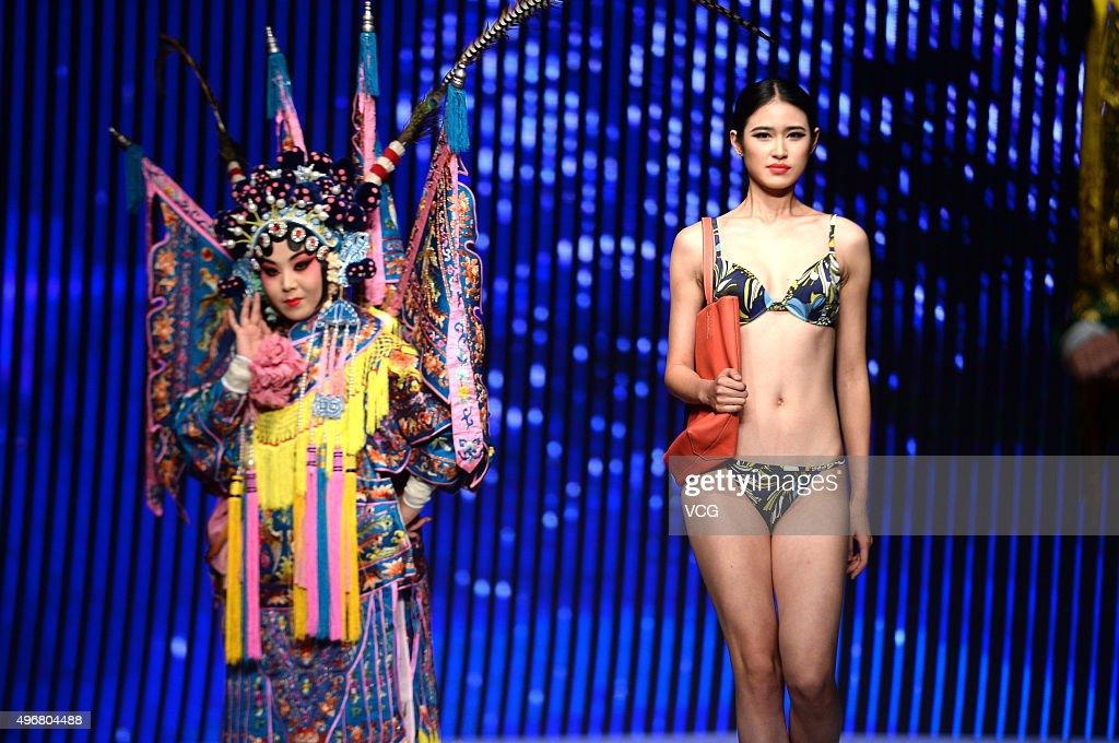 Bikini Models Share Stage With Peking Opera In Jinan : News Photo