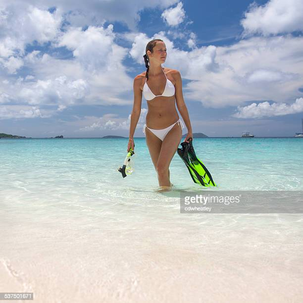 bikini woman with snorkel equipment in the Caribbean waters
