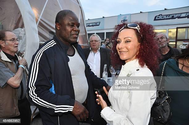 Biko Botowamungu and Christina Lugner arrive at the Nascar Charity Race Event at Paddock Club on September 4 2014 in Vienna Austria