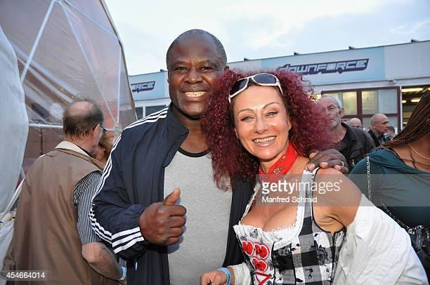 Biko Botowamungu and Christina Lugner attend the Nascar Charity Race Event at Paddock Club on September 4 2014 in Vienna Austria