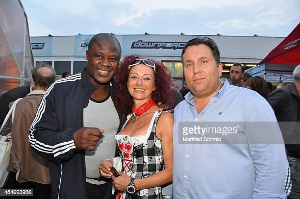 Biko Botowamungu Christina Lugner and Dietmar Schwingenschrot attend the Nascar Charity Race Event at Paddock Club on September 4 2014 in Vienna...