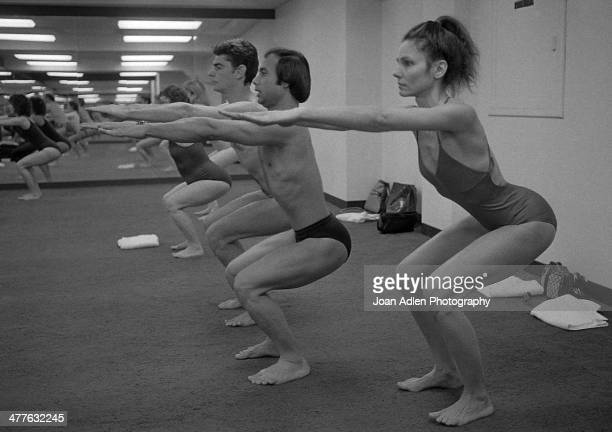 Bikram Choudhury teacher and founder of Bikram Yoga demonstrates the 'Awkard Pose' with actress Paula Prentiss and her husband actor Richard Benjamin...