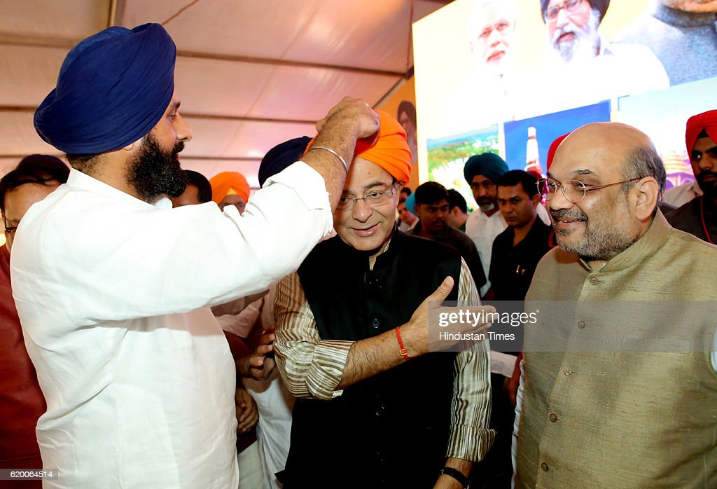 Bikram Singh Majithia Punjab Revenue Minister tying the turban to Union Finance Minister Arun Jaitley Bharatiya Janata Party National President Amit..
