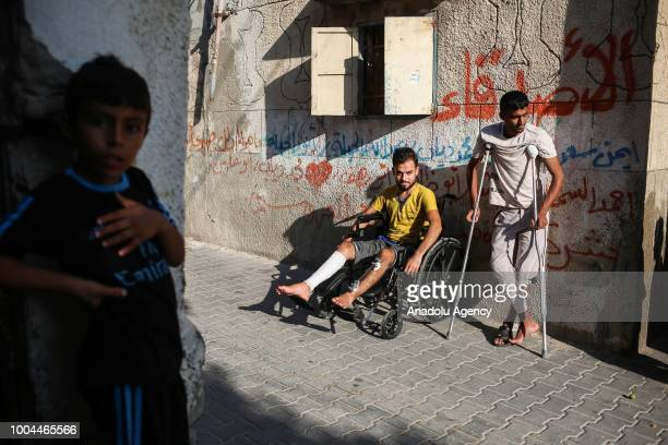 Bilal and Said Diyab are seen with crutches and a wheelchair after Israeli forces opened fire on demonstrators and their siblings Muhammed and Ahmed...