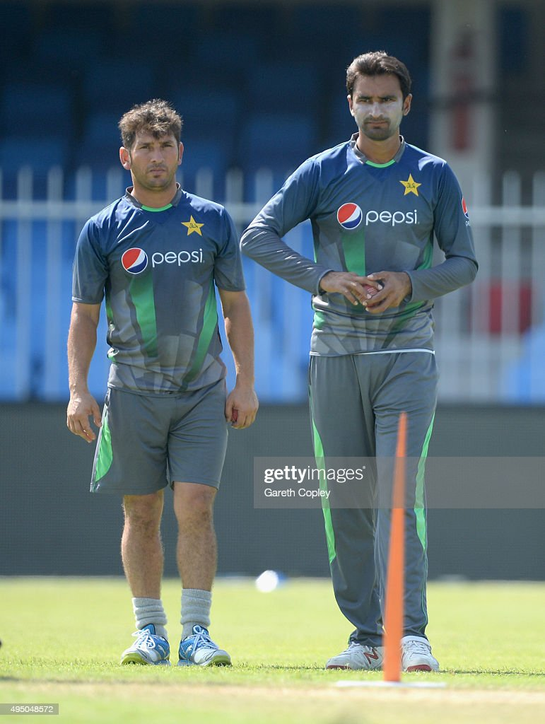 Bilal Asif of Pakistan bowls watched by Yasir Shah during a nets session at Sharjah Cricket Stadium on October 31, 2015 in Sharjah, United Arab Emirates.