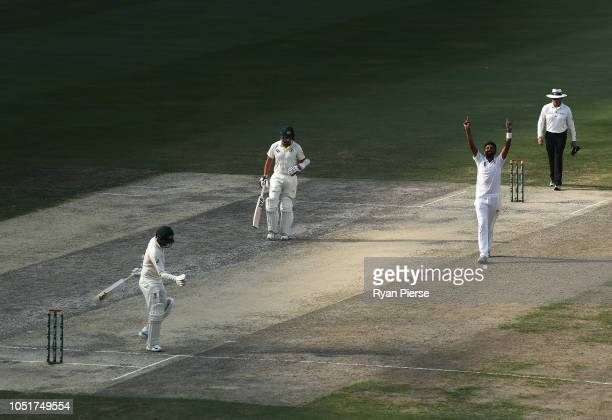 Bilal Asif of Pakistan celebrates after claiming his sixth wicket of the innings the wicket of Nathan Lyon of Australia during day three of the First...