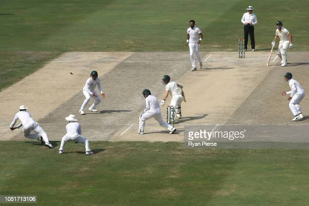 Bilal Asif of Pakistan dismisses Travis Head of Australia during day three of the First Test match in the series between Australia and Pakistan at...