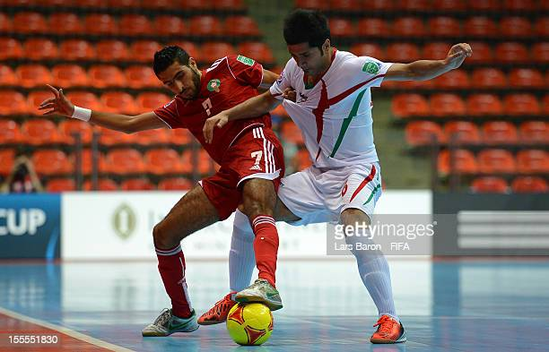 Bilal Assoufi of Morocco challenges Afshin Kazemi of Iran during the FIFA Futsal World Cup Group B match between Morocco and Iran at Indoor Stadium...