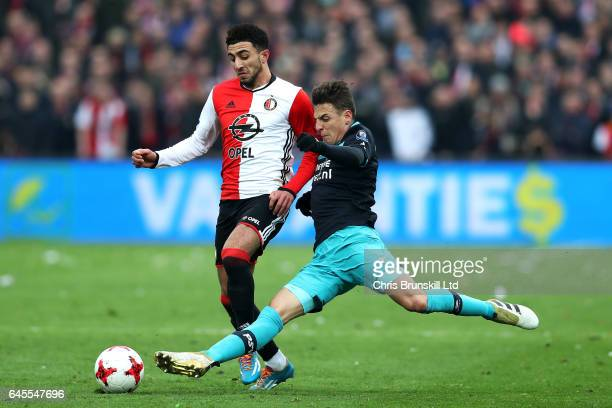 Bilal Basacikoglu of Feyenoord is tackled by Santiago Arias of PSV Eindhoven during the Dutch Eredivisie match between Feyenoord and PSV Eindhoven at...