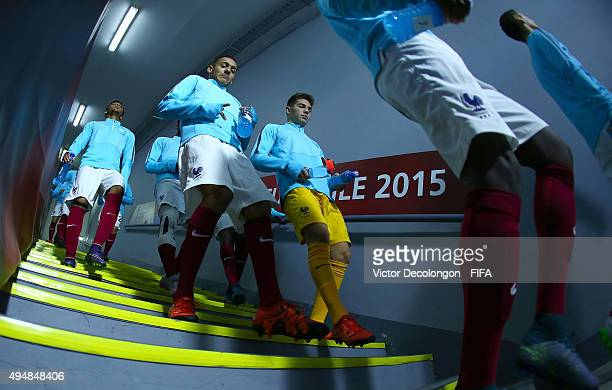Bilal Boutobba and Luca Zidane of France walk with their teammates to the pitch for warmup prior to the France v Costa Rica Round of 16 FIFA U17...